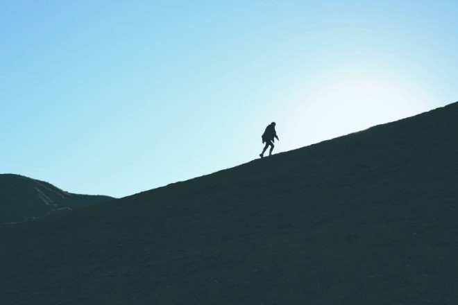a man who did not quit walking up the side of a mountain
